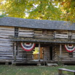Tour 14 Lincoln-era replica cabins and an artifact-filled museum.