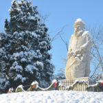The 22-foot-tall statue towers on top of the hill at Santa Claus Museum & Village.