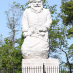 The historic Santa statue stands at 22 feet tall.