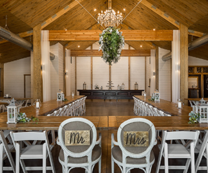 Inside of Matilda's Event Barn set up for wedding with Mr. and Mrs. chairs