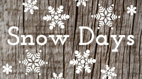 "Wood background with snowflakes and the text ""snow days"""