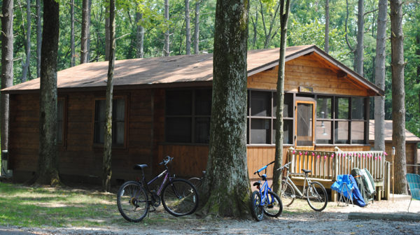 Cabin with bikes parked in front at Lincoln State Park