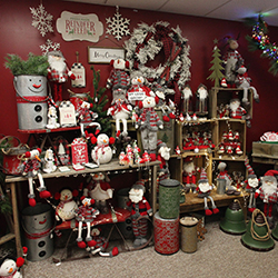 Christmas decorations and gifts arranged on shelves and wall at Evergreen Boutique & Christmas Shop