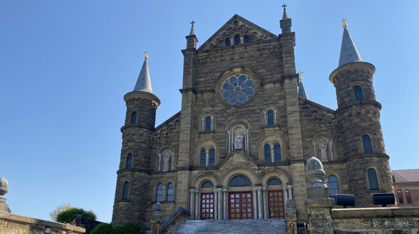 Front of Saint Meinrad Archabbey Church in spring with a blue sky